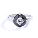 Ring - round-cut diamond is surrounded by marquise-cut black onyx