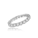 eternity band with round stone in white gold ring