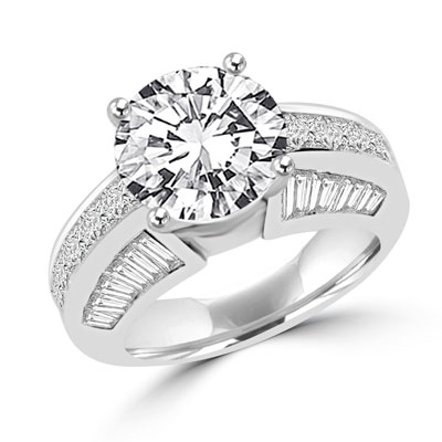 Diamond Essence Designer Ring with 3.50 Cts. Round Brilliant Center, set off by Chanel set Princess stones and Tapered Baguettes on either side.5.50 Cts.T.W. set in 14K Solid White Gold.