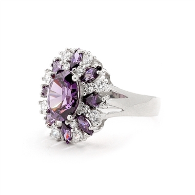 This designer ring is just perfect for party lovers to show-off. 3.0 ct. oval cut amethyst, surrounded by 8 small amethyst marquise,1.3 cts.and white round stones 0.80 cts. all around it, 5.10 cts T.W. set in 14K Solid White Gold.