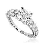 Engagement Ring With Princess Cut Diamond Essence Set in Center accompanied by Round Brilliant Diamond Essence going down the band. 3.25 Cts. T.W. set in 14K Solid White Gold.