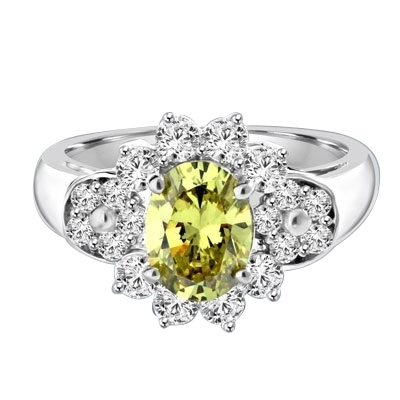 Floral Ring - 1.25 Cts. Oval cut Peridot Essence set in center with Round brilliant Diamond Essence on top and bottom and cluster of Melee, making floral design, on either side of band. 2.0 Cts. T.W. set in 14K Solid White Gold.