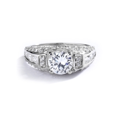 Engagement Ring- 1.0 Ct. round Brilliant Diamond Essence in center with Chanel set Baguettes and Melee going half way down the band. 2.0 Cts. T.W. set in 14K Solid White Gold.