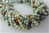 AMAZONITE BLACK&GOLD FACETED ROUND - 6mm