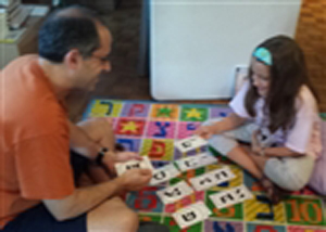 Lily and Dad Playing a Game of Alef Bet Fish