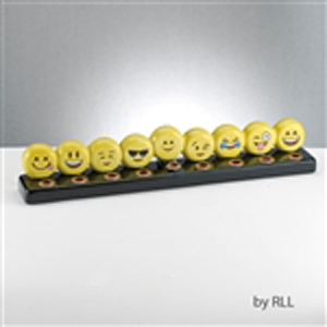 Bright yellow hand-painted ceramic menorah that winks and smiles!