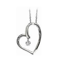 Floating diamond heart pendant in 14K white gold.