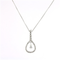 Floating diamond pendant in 14K white gold.