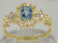 Dainty 9K Yellow Gold Aquamarine and Diamond Trilogy Ring