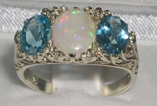 Opulent 9K White Gold Opal and Blue Topaz Trilogy Ring