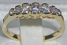 Elegant 9K Yellow Gold Seven Stone Tanzanite Ring