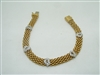 18k (750) yellow and white gold cubic zircon heart bracelet