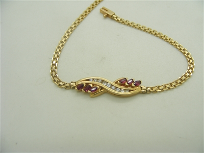 14k yellow gold womans bracelet Diamonds and ruby's