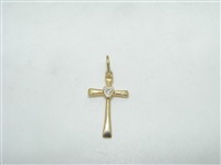 Diamond cross pendant with a heart