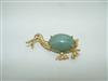 14k yellow gold duck pin with a jade