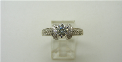 14 K White Gold Diamond Engagement Ring with Accents.