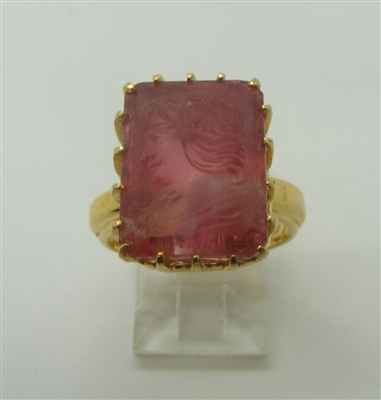 Woman Carved Rubellite Ring. (14 K Yellow Gold)