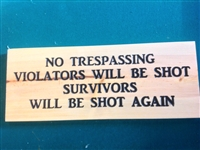Carved sign: No Trespassing Violators will be Shot, Survivors will be shot again