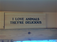 Carved sign: I Love Animals, They're Delicious