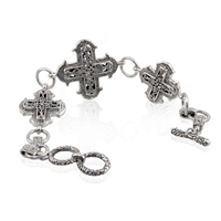 Sterling Silver Scroll Work Raised Cross Toggle Bracelet