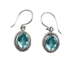 Sterling Silver Faceted Oval Blue Topaz Dangle Earrings