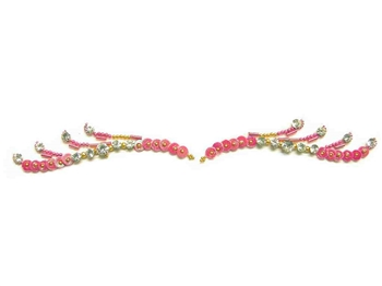 Pink sequins and decorations with white crystals in the perfect shape to use as eye liner or eye brows.