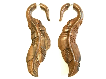 Wooden earrings carved in a long feather style.