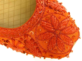 Bright orange silk shoes with matching beads and sequins.