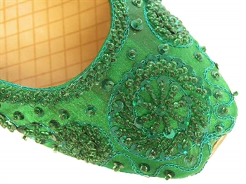 Khussa shoes in emerald green silk with matching beads and sequins.