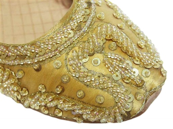 Gold silk with iridescent beads and mirror sequins.