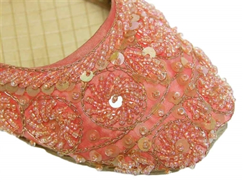 Shoes in bright salmon peach silk with matching beads and sequins.