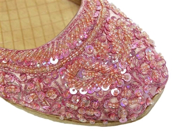 Light rose pink silk shoes with matching beads and sequins.