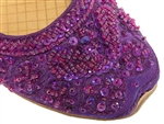 Jewel toned purple silk with matching beads and sequins in Bollywood style shoes.