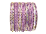 Lavender, purple, and gold glass bangles with glitter accents.