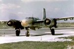 Color photo of a 416th bomb group A-26 medium bomber on the runway ready for takeoff.