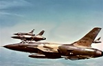 Photo of Republic F-105 Thunderchief fighter bombers on a mission high over the jungles of Vietnam