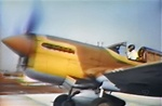 World War 2 color photo of Curtiss P-40 Warhawk taking off from the film Ways of the Warhawk.