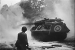 Photo of an M110 Tank Destroyer in action in Normandy during World War 2 from the Academy Award winning  documentary film, The True Glory.
