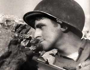 Photo of a GI in Italy taken from John Huston's award winning World War 2 film film The Battle of San Pietro.
