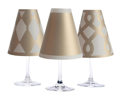 Set of 6 coordinating drum, scroll and solid pattern translucent paper white wine glass shades.  Available in silver and gold.  Made in the USA.