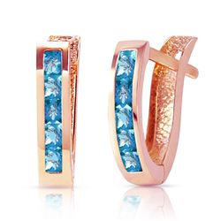 ALARRI 1.2 Carat 14K Solid Rose Gold Oval Huggie Earrings Blue Topaz