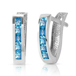 ALARRI 1.2 CTW 14K Solid White Gold Oval Huggie Earrings Blue Topaz