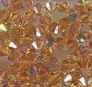 Swarovski 4mm 5301/5328 Bicone - Topaz AB Color