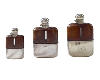 Set of Three Vintage Silver and Stamped Leather Hip Flasks