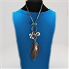 Silver Necklace with Large Silver Leaf, Flower, Bead and Turquoise Charms