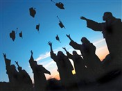 8830 GD Grads throw caps in air