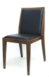 Upscale Restaurant Upholstered Metal Dining Chair with wood grain.