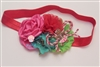 Hot pink, red, seafoam, and lime with a gingerbread girl. Shown on solid red foldover elastic