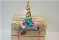 Unicorn horn in light pink, lavender, and turquoise. Absolutely perfect for any little unicorn lover!
