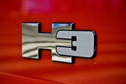 Factory replacement logo for rear of Hummer H3